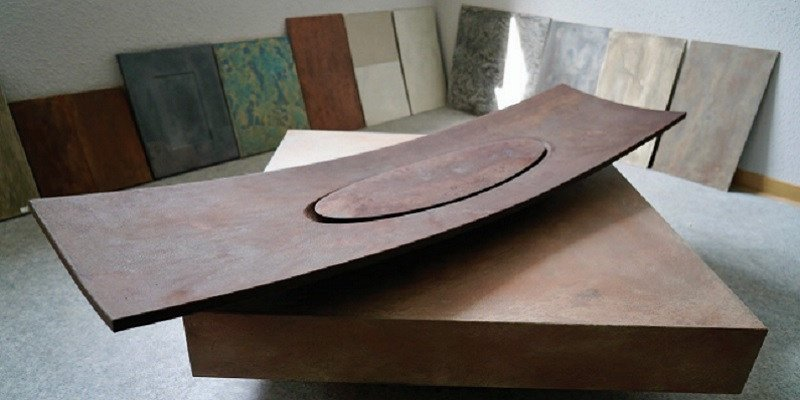 """The """"Magna Patero Ortus"""" a rust-coloured 3D printed sink."""