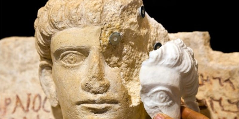 A Palmyra bust, with a repared 3D printed section being secured with magnets.