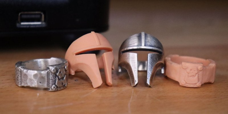 A pair of ring sculpts, as both 3D prints and lost wax casts