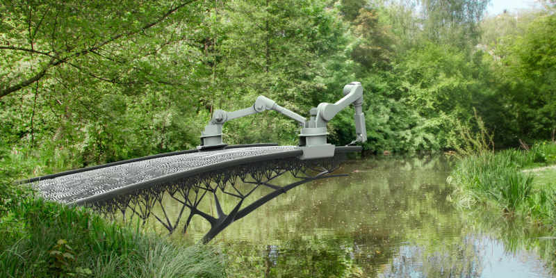 Two robots building a 3D printed bridge over a stream.